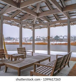 Clear Square Snowy patio of a clubhouse overlooking Oquirh Lake