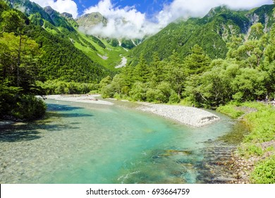 Clear stream and Hodaka chain of mountains of cloud
