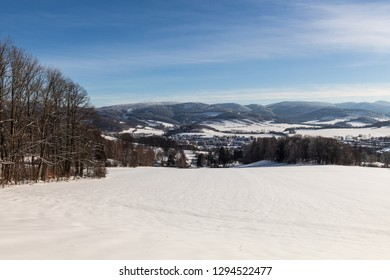 Clear sunny sky with a beautiful landscape on snow covered trees in a evanescent Christmas morning in the mountains.
