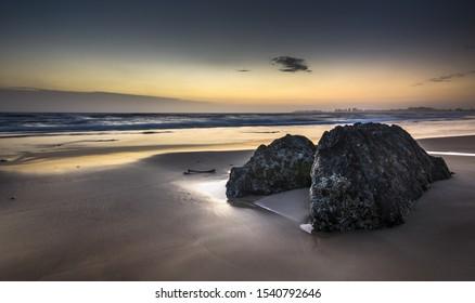clear sunrise Currumbin beach gold coast Queensland Australia rocky shore reflections ocean waves sandy