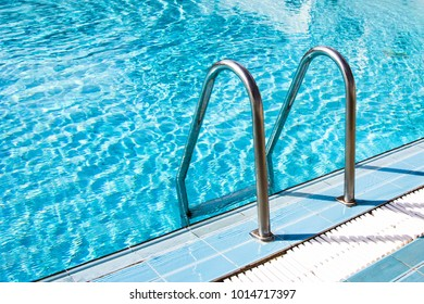 Clear transparent pool water and railings