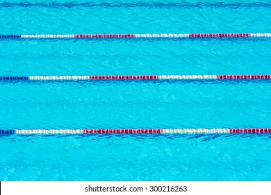 Clear transparent swimming pool water background. Horizontal shot