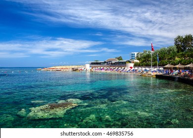 Clear turquoise sea waters at the beach in Kusadasi, Turkey