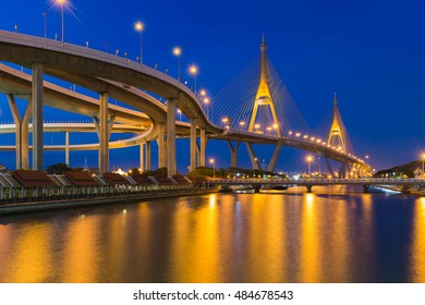 Clear twilight sky over Suspension bridge connect to highway intersection riverfront