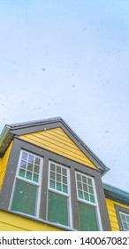 Clear Vertical Exterior of a home in Daybreak Utah with cloudy sky background in winter