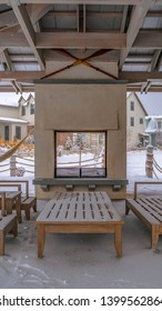 Clear Vertical Seating on the snowy patio of a clubhouse in Utah