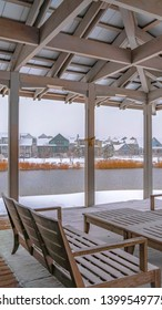 Clear Vertical Snowy patio of a clubhouse overlooking Oquirh Lake