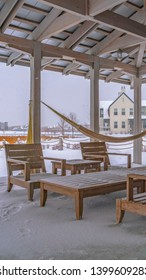 Clear Vertical Snowy patio of a clubhouse in Daybreak Utah