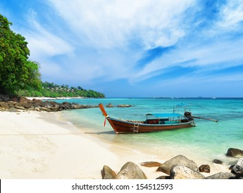 Clear water and blue sky. Beach of Phi Phi Island, Thailand.