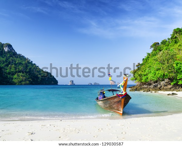 Clear water and blue sky. Beach in Krabi province, Thailand.