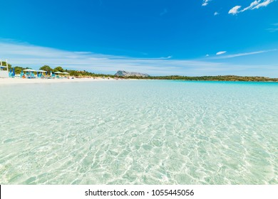 Clear water and blue sky in Cala Brandinchi, Costa Smeralda. Sardinia, Italy
