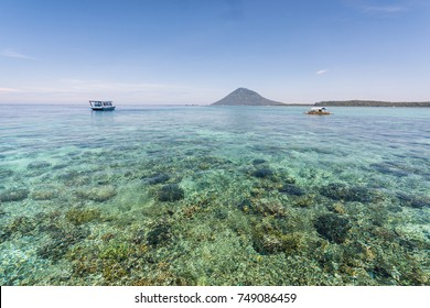 Clear water full of coral off the coast of the famous Bunaken island, a diving paradise, near Manado in North Sulawesi, Indonesia