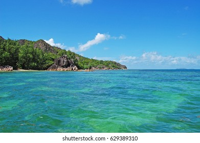 Clear water on a wild island in Seychelles