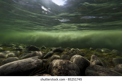 Clear water river and melting water river mixing under water, Sondrestrom (Kangerlussuaq), Greenland.