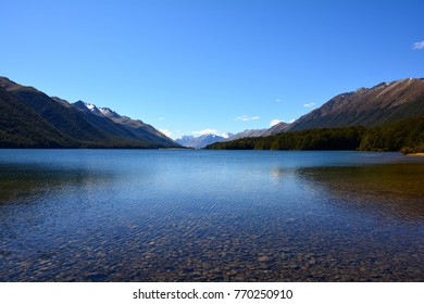 Clear water of sunny day at shore of south lake Mavora in south island, New zealand.