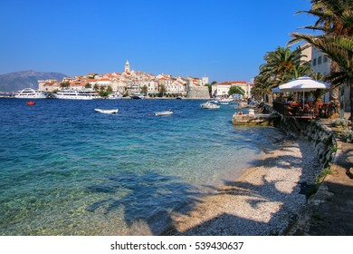 Clear water at the waterfront of Korcula town, Croatia. Korcula is a historic fortified town on the protected east coast of the island of Korcula