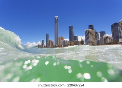 Clear waves rolling on Surfers Paradise beach on Gold Coast, Australia