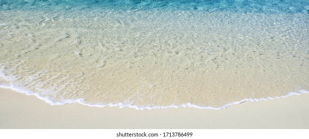clear yellow sand water on the beach