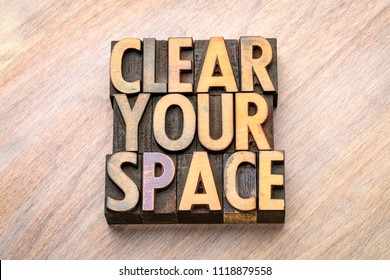 clear your space - word abstract in vintage letterpress wood type, declutter concept