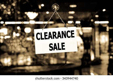 A Clearance sale sign hanging in a shop window