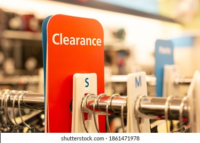 Clearance sign in a clothes department store. On sale section.