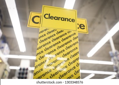 A clearance sign indicates that all items are for sale at a discounted price in a retail store.