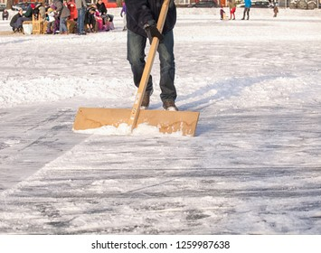 Clearing ice from snow for ice skating