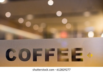 """Clearly Etched """"Coffee"""" on Glass Window with Shop, Cafe, Restaurant Lighting in Background"""