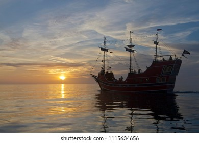 CLEARWATER BAY, CLEARWATER, FLORIDA-FEBRUARY 7, 2018: Silhoutted pirate ship, a historic replica, ferries tourists around scenic Clearwater Bay at sunset