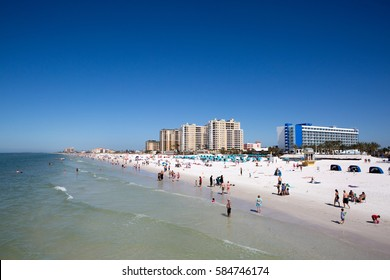 CLEARWATER BEACH, FLORIDA - FEBRUARY 12, 2017: Vacationers play on Clearwater Beach, Florida, USA, on February 12, 2017.