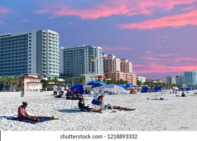 Clearwater Beach, Florida. October 18, 2018 People relaxing at the beach on colorful sunset background.