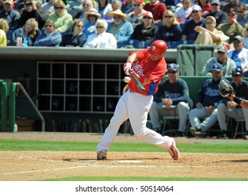 CLEARWATER, FL - MARCH 23: Philadelphia Phillies catcher Brian Schneider connects with a pitch in the March 23, 2010 spring training game in Clearwater, FL