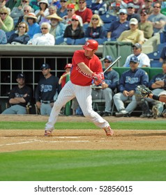 CLEARWATER, FL - MARCH 23: Philadelphia Phillies catcher Brian Schneider swings at a pitch late in a spring training game on March 23, 2010 in Clearwater, FL.