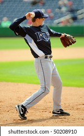 CLEARWATER, FL - MARCH 23: Tampa Bay Rays utility player Elliot Johnson prepares to throw the ball during pregame infield drills March 23, 2010 in Clearwater, FL