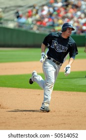 CLEARWATER, FL - MARCH 23: Tampa Bay Rays outfielder Matt Joyce digs for third base late in the March 23, 2010 spring training game in CLearwater, FL