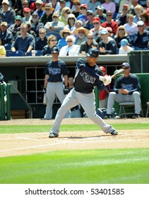 CLEARWATER, FL - MARCH 23: Tampa Bay Rays first baseman Carlos Pena begins his swing in a spring training game on March 23, 2010 in Clearwater, FL