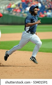 CLEARWATER, FL - MARCH 23: Tampa Bay Rays rookie Rasahd Eldridge pulls into third base running the bases late in a spring training game on March 23, 2010 in Clearwater, FL