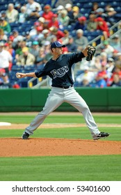 CLEARWATER, FL - MARCH 23: Tampa Bay Rays reliever Grant Balfour delivers a pitch late in a spring training game on March 23, 2010 in Clearwater, FL