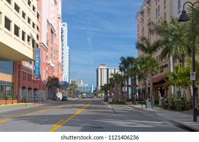 CLEARWATER, FLORIDA, USA - FEBRUARY 7, 2018: Shady, quiet, colorful, palm tree lined street in downtown Clearwater, Florida in the southern USA, a popular spot for tourists trying to escape winter