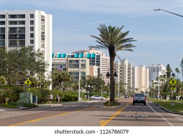 CLEARWATER, FLORIDA, USA - FEBRUARY 7, 2018: Downtown Clearwater, Florida with palm trees, colorful buildings and lots of bright sunshine.  Clearwater is a popular winter vacation spot for tourists.