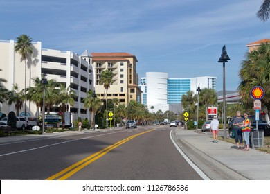 CLEARWATER, FLORIDA, USA - FEBRUARY 7, 2018: Downtown Clearwater, Florida with cars, palm trees, colorful buildings and lots of bright sunshine.  Clearwater is a popular spot for tourists and retirees
