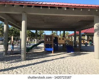 Clearwater, Florida, USA, June 11, 2019: A beautiful and sturdy wooden playground and covered with tiles, colorful toys, on the white sands of Clearwater Beach