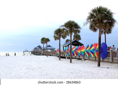 Clearwater Sandy Beach with Pier and colorful umbrellas