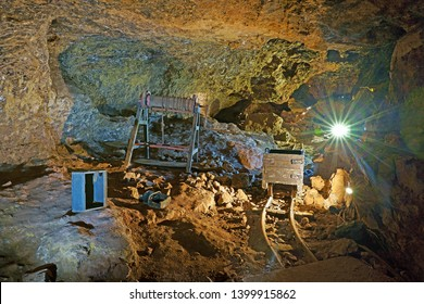 Clearwell, near Coleford, Forest of Dean, Gloucestershire, UK, May 15th, 2019, a pre set working area with bogie and transport tracks in Clearwell Caves.