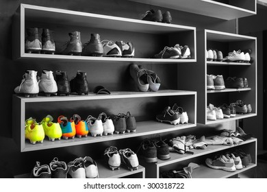 A lot of cleats , soccer boots on shoe rack at soccer  football club prepared before football player traning or match competition