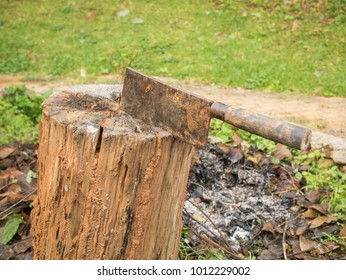 Cleaver in a wooden stump