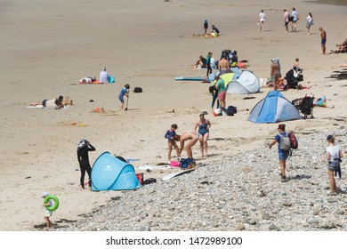 CLEDEN CAP SIZUN, FRANCE – AUGUST 06, 2019 : people at the beach in baie des trepasses