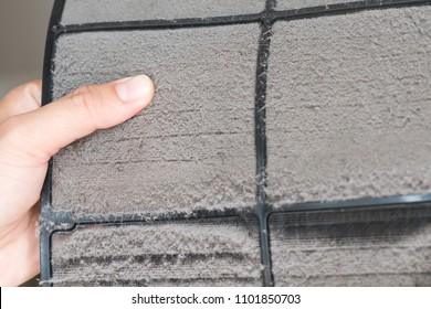 cleen out dust from air conditioner filter