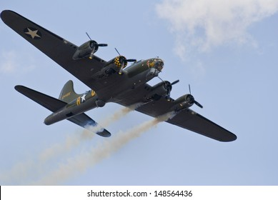 """CLEETHORPES AIRSHOW, UK - JULY 28:  Boeing B-17G Flying Fortress """"Sally B"""" at Cleethorpes Airshow event, July 28, 2013, Lincolnshire. The last remaining airworthy B-17 in Europe."""