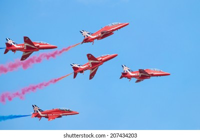 CLEETHORPES, ENGLAND JULY 27TH: Royal Air Force Red arrows perform an aerobatic display at Cleethropes airshow on 27th July 2014 in Cleethorpes England.